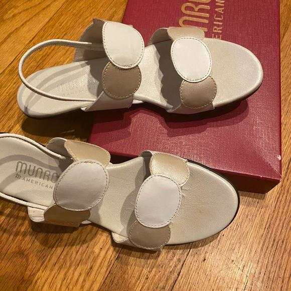 White/beige Munro low heeled sandals.
